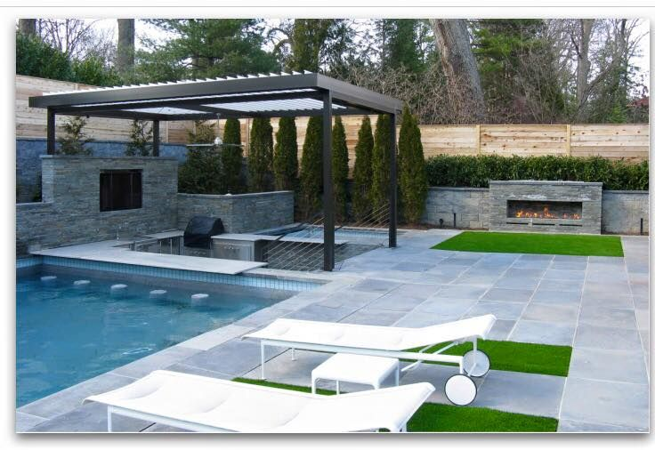 This incredible backyard oasis is ready for entertaining, rain or shine with this Equinox Adjustable Louvered Roof. Swim up bar and grill? Yes please! Gorgeous design, Fine Earth Landscape, Inc! Want an Equinox for your Northern Virginia home or business? Visit http://www.coreoutdoor.com/. Mention this post with code KC516 and get a $50 Home Depot Gift certificate when you buy an Equinox Adjustable Louvered Roof! #louveredroof #equinoxadjustableroof #pergola #outdoorliving