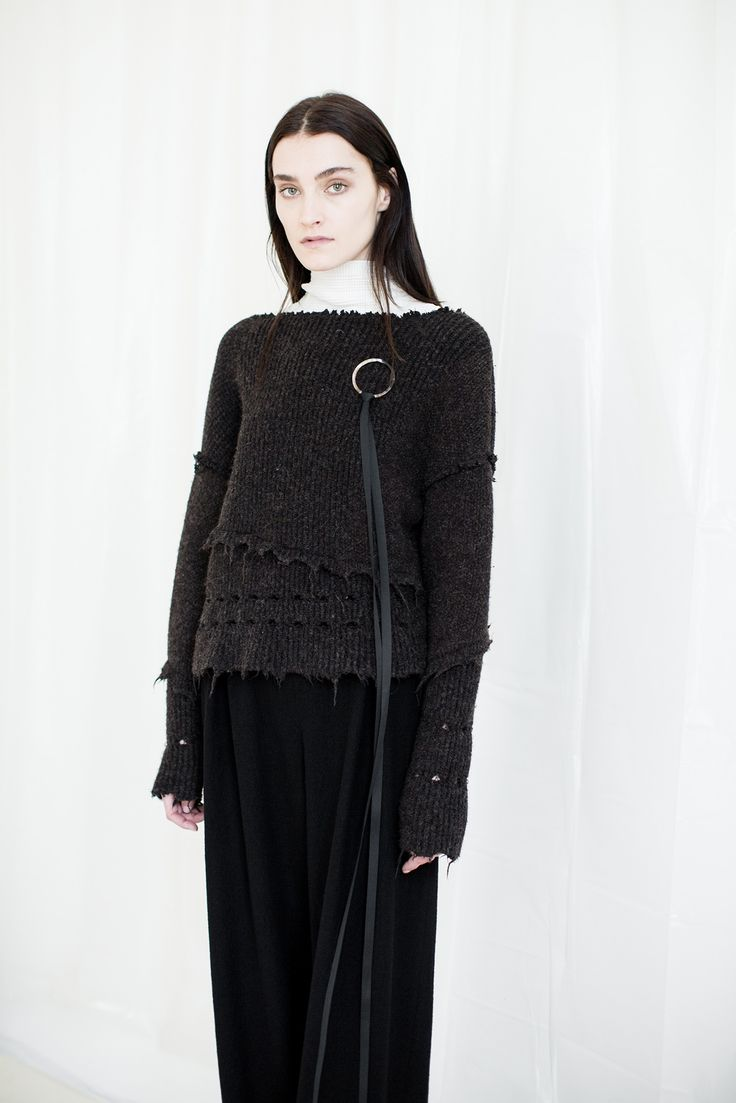 The raw finishes of the knitwear is interesting and adds a sense of minimalism and interest. The knit has a contrast texture leather thin straps attached to a silver ring which add a different texture to the piece. The high neck contrast of the undergarment reminds me of religious connotations; adding a somber tone.  Damir Doma F/W 2015 Credit: style.com