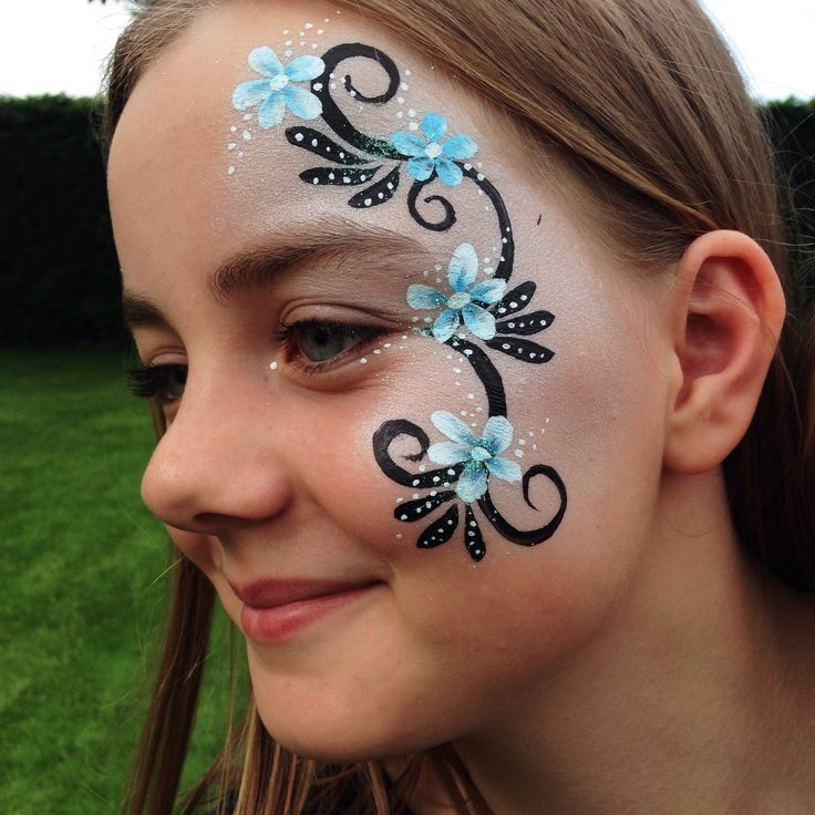 Face painting - flowers and swirls design.