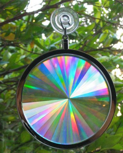 "AXICON RAINBOW WINDOW SUNCATCHER 4"" Holographic Prismatic Suncatcher Your Axicon Rainbow Window Suncatcher™ state-of-the-art Holographic Prism starts with laser technology and ends with pure spectral"