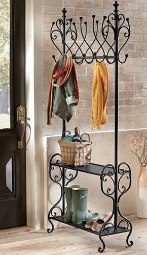 Even the addition of one item can visually define your entry area. A tall potted plant or a hall tree both serve the purpose well. When space is at a minimum, try a wall-mount coat rack instead of a free-standing one. You'll get all the practicality without having to take up any of your area's footprint. A nice throw rug finishes the look and gives shoes a place to land.