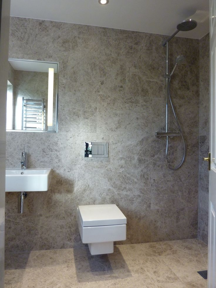 The Silver Shadow Honed Marble Gives This Wet Room A