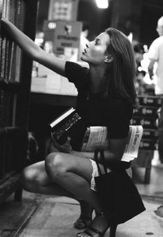 Finding the perfect next book.  Model: Christy Turlington. Photographer: Pamela Hanson