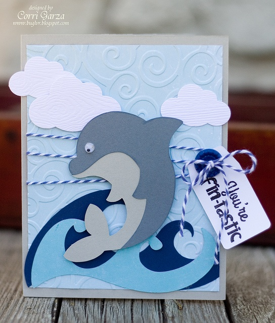 Do you want to design a card fast and quick and need something cute to put on the front? TROPICAL FRIENDS SVG COLLECTION has great files to choose from! Corri's card is fun and adorable and perfect for anyone who loves the sea! The little dolphin is so cute! Oh, and the blue waves are a freebie! Check it out here: http://svgcuts.com/blog/2010/06/19/free-svg-file-sure-cuts-a-lot-06-19-10-waves-element/