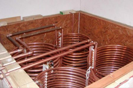 solar heat storage tank and copper coil heat exchangers (Excellent look at the exchange coils in a storage tank!)