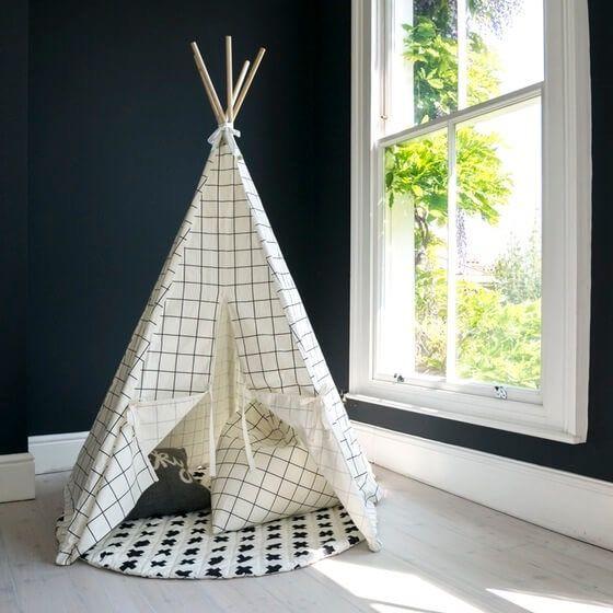 White and black grid print kids play teepee with white herringbone trim 100% Cotton tent and ties 5 x 20cm diameter tulipwood poles create the...