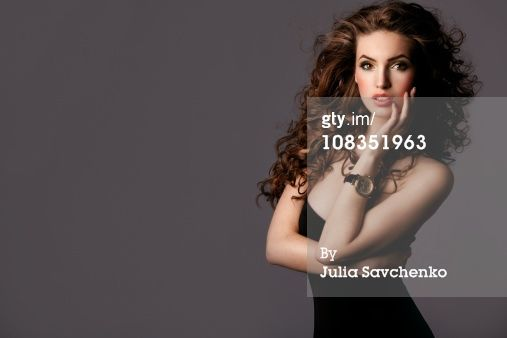 Title: Beautiful woman with watches Creative image #: 108351963 License type: Royalty-free Photographer: Julia Savchenko Collection: Vetta Credit: Julia Savchenko Release information:This image has a signed model release. This image is available for commercial use.