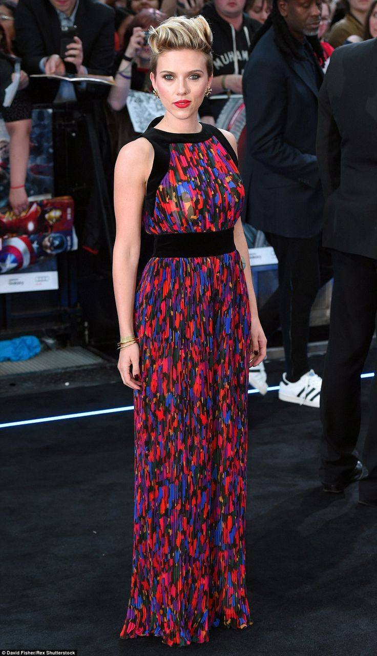 Bringing some colour: Scarlett Johansson stood out in a multi-coloured Balmain jumpsuit as she arrived at the UK premiere of Avengers: Age Of Ultron in London on Tuesday