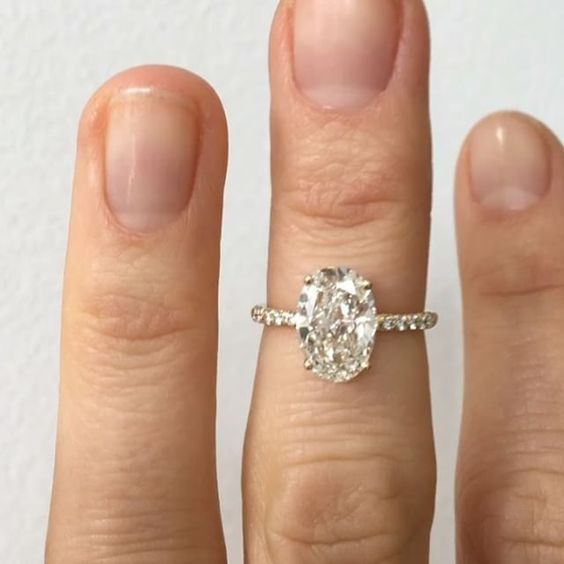 bah..Custom solitaire engagement ring with a 1.50 carat G/VS1 oval cut white diamond. Set in 14k yellow gold with white diamond micro pave. If you're interested in a custom ring email custom@mociun.com or check out the Williamsburg store and mociun.com