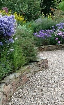 Dry stone wall forming raised borders