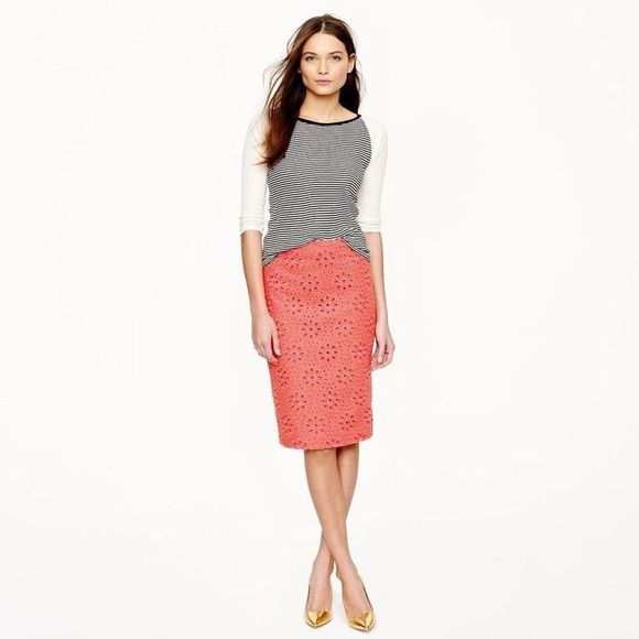 NWOT J. Crew Eyelet Pencil Skirt No. 2 pencil skirt in floral pinwheel eyelet. Coral color. Back zip with hook and eye closure. Sits above waist. Back slit. Completely lined. Shell: 100% Cotton. Embroidery: 100% Polyester. Lining: 97% Cotton, 3% Spandex. New without tags. J. Crew Skirts Pencil