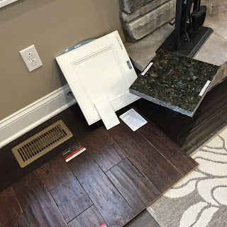 """Materials we chose for new house: Dark wood floor (Armstrong American Scrape Hickory Smokehouse EA5508, 5"""" wide).  Verde butterfly granite. White cabinets, white subway tiles (to be tiled horizontally). Ignore the beige paint."""