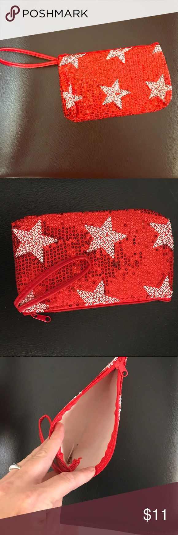New red stars and sparkle wristlet cosmetic bag 💼 Beautiful new little red and white sequin stars and sparkle wristlet also can be used as a small cosmetic bag new in package as seen in pictures Bags Clutches & Wristlets