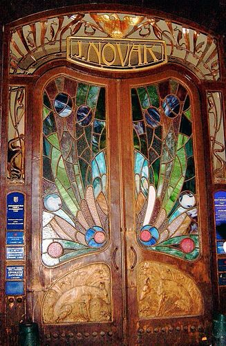 Stained glass door on the brewery street in Prague