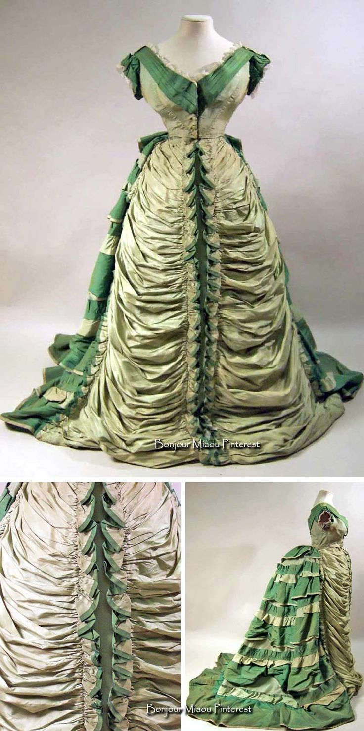 Evening dress ca. 1874–76. Light green finely corded silk trimmed with leaf green silk stripes. Bodice lined with white silk. Low V neckline back and front. Front fastening to waist with buttons. Band of leaf green silk in pleats round neckline with deep V back and front, concealing top two buttons. Very short, leaf green puffed sleeves. Skirt pleated with frills and piped. Back in light green with train. Manchester Art Gallery