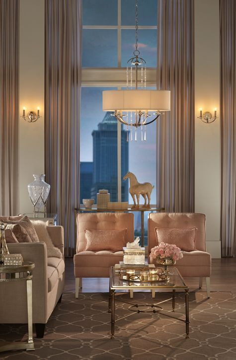 Luxurious living room in cream and soft pink. Magnificent windows. .
