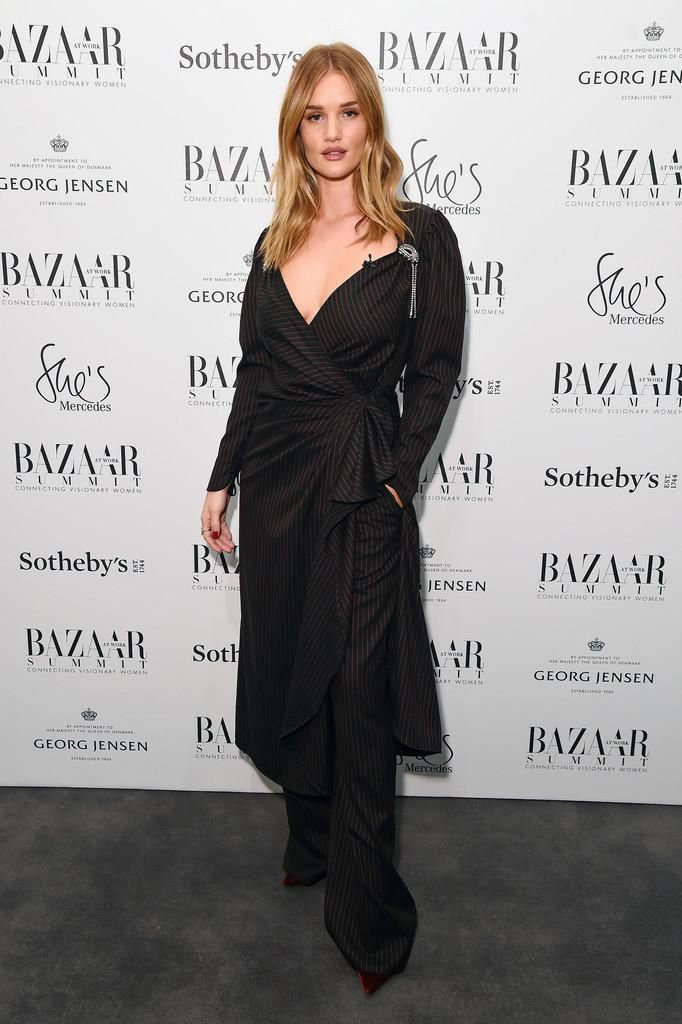Rosie Huntington-Whiteley wearing The Chaos Metallic Initial Case Iphone 7, Christian Louboutin Pigalle Follies 100 Velvet Pumps, Attico Caterina Trousers, Attico Pat Pinstriped Stretch-Wool Midi Dress, Neil Lane Cushion Cut Diamond and Platinum Engagement Ring, Jessica McCormack Diamonds Hexagonal Ring and Anita Ko 18k White Gold Extra Large Diamond Pave and Baguette Wrap Leaf Ring