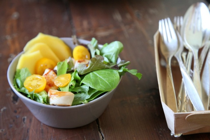 Chicken salad with yellow tomatoes and mango