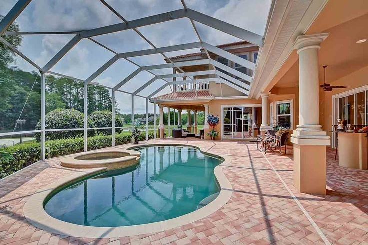 This golf course home for sale includes a large meandering for Pool design course