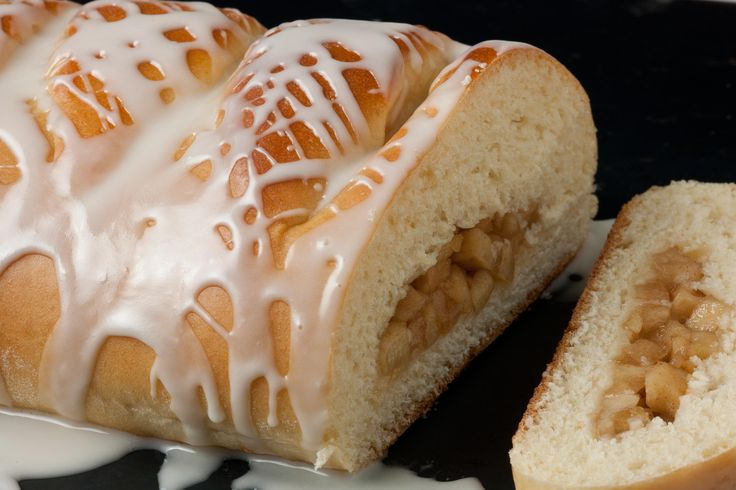 This yeasted and braided coffee cake has an apple, ginger, and cinnamon filling and is drizzled with a sweet vanilla glaze.