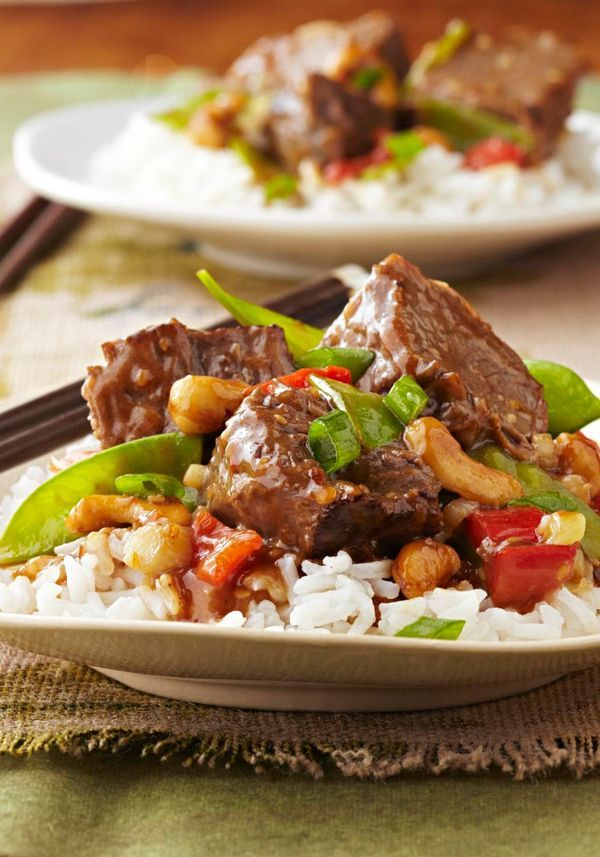 Slow-Cooker Asian-Style Beef — In this recipe, chunks of beef get meltingly tender in the slow cooker, simmered in an Asian-inspired blend of toasted sesame dressing, garlic, and teriyaki sauce.