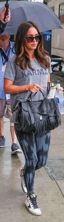 Who made  Megan Fox's black sunglasses, gray Karma print tee, fringe handbag, and white star sneakers?