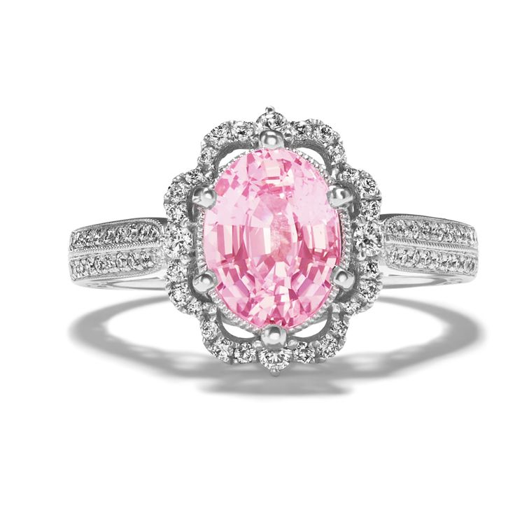 What makes a vintage-inspired engagement ring even better? A pink sapphire. This...