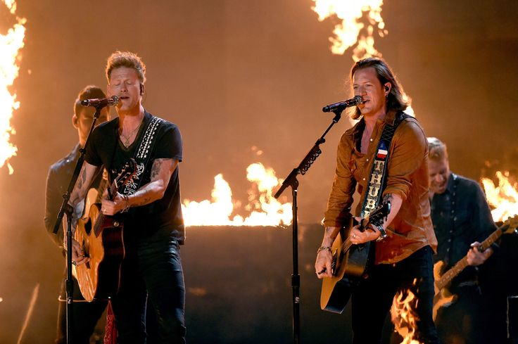2015 ACM Awards - Musicians Brian Kelley (left) and Tyler Hubbard of Florida Georgia Line perform onstage during the 50th Academy Of Country Music Awards at AT&T Stadium on April 19, 2015 in Arlington, Texas.Florida Georgia Line WON for Vocal Duo of the Year, and also Vocal Event of the Year with Luke Bryan.