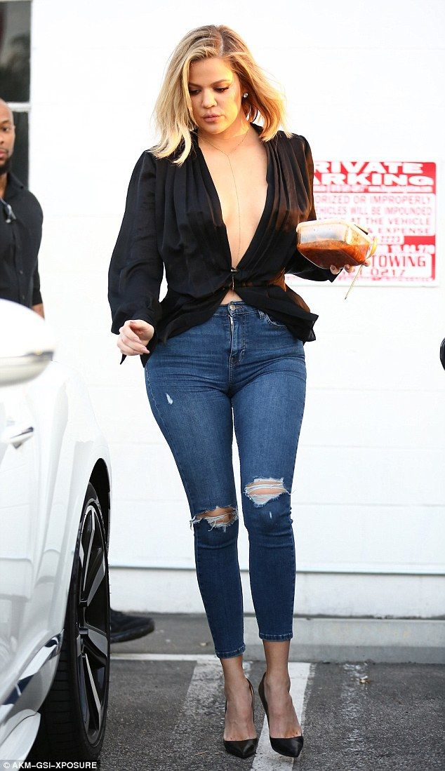 Eye-popping: Khloe Kardashian turned heads in a very low-cut top while out and about in Van Nuys on Tuesday