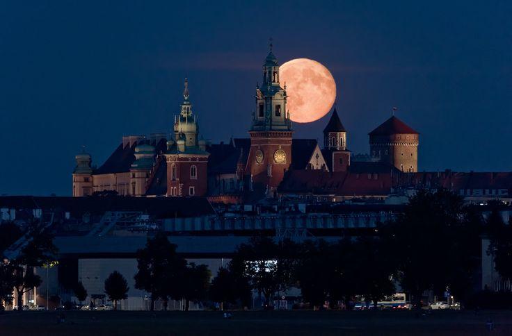 1st August 2015 The Full Moon rising over Wawel Castle in Kraków, Poland.