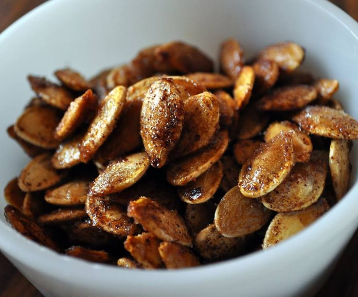 """Cinnamon Pumpkin Seeds.  Kids will love these.  Make use of those """"Jack-O-Lantern"""" brains. 1 1/2 cups Pumkin Seeds Rinsed and patted dry 2 tablespoons melted butter 2 tablespoons sugar 1 1/2 teaspoons ground cinnamon Heat oven to 325°F. In small bowl, mix all ingredients. Spread on ungreased cookie sheet in single layer. Bake about 20 minutes, stirring once or twice, until seeds begin to brown. Cool. Add a dash of salt for a sweet and salty flavor."""