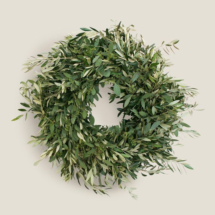 A fresh take on the traditional green wreath, this olive and eucalyptus wreath is a great way to bring a bit of the outdoors in. Each wreath is handcrafted with care and attention by a small family-operated farm in Northern California.