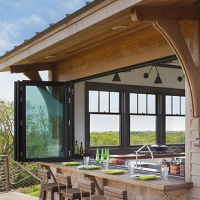 Kitchen window opens to a bar outside.  Perfect for entertaining and bringing the outdoors in or the indoors out.  I love it.