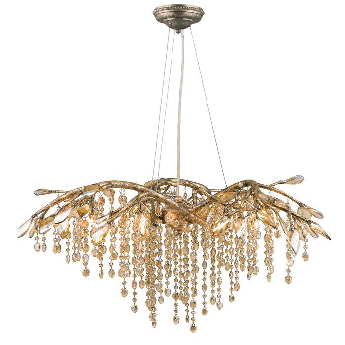 Like dewdrops under a forest canopy, House of Hampton's Rosalynn Collection displays glistening glass beads that cascade from organic leaves and branches. This nod to nature gets a modern twist with a mystic gold finish making it a natural in contemporary settings. G4 halogen bulbs provide the inner light source that causes sparkle to reflect playfully off the countless gleaming surfaces, and sparks both curiosity and conversation. This 6-light chandelier creates a stylish focal point…