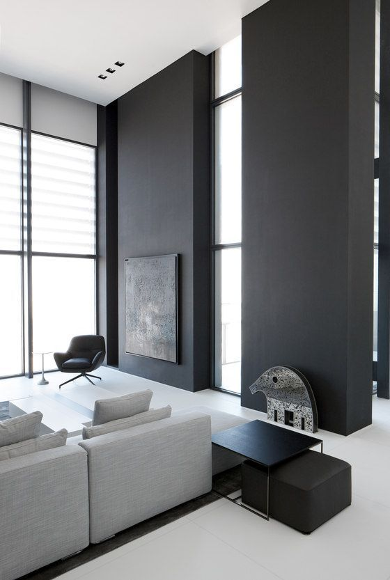 .Light interior with large black wall as accent. The Index penthouse by Studio M.