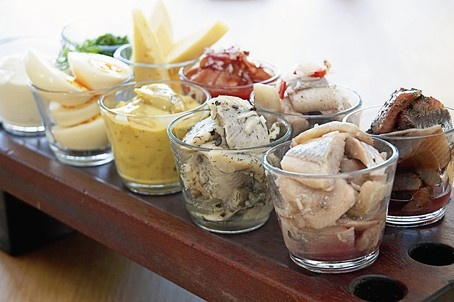 """Pickled Herring. We eat a lot of them.:)  On a """"Smörgåsbord"""", on our Christmas bord, in celbrating Eastern and of course in the big Midsummer feasts."""