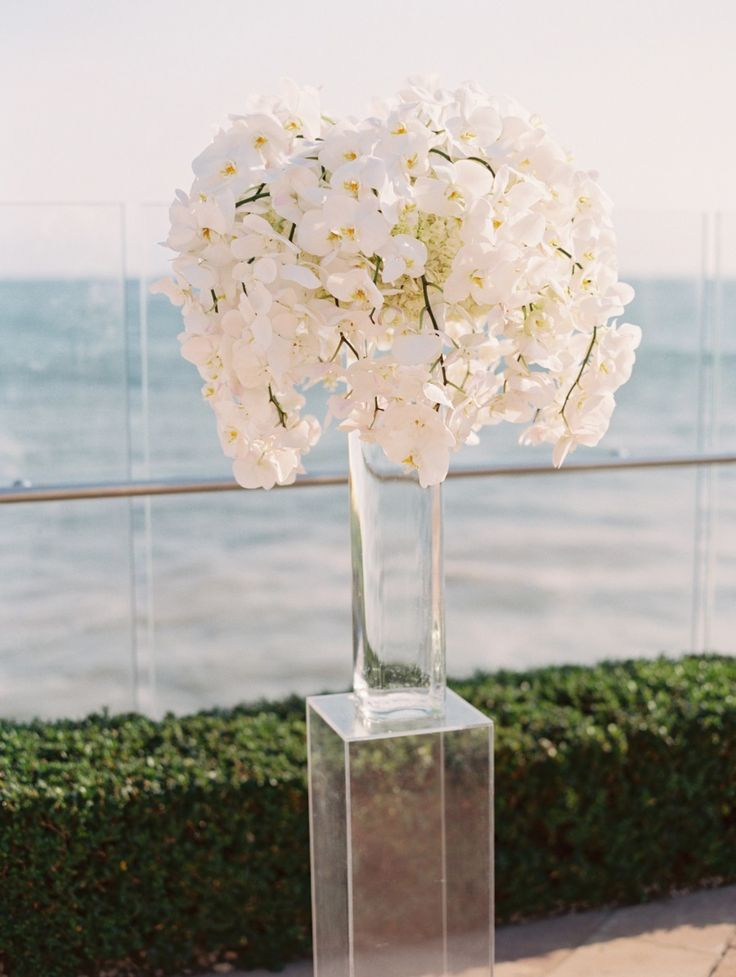 Glass on Glass - See this Elegant Wedding on SMP: http://www.stylemepretty.com/2013/12/18/santa-barbara-seaside-wedding | Lane Dittoe Fine Art Wedding Photographs | #Orchids