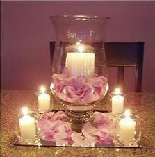 This vase + candle is similar to what they have at the venue. Maybe you could do something similar?