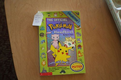 You never know what you'll find in our ebay store...who doesn't need The Official Pokemon Handbook Vol. 1 - 1999