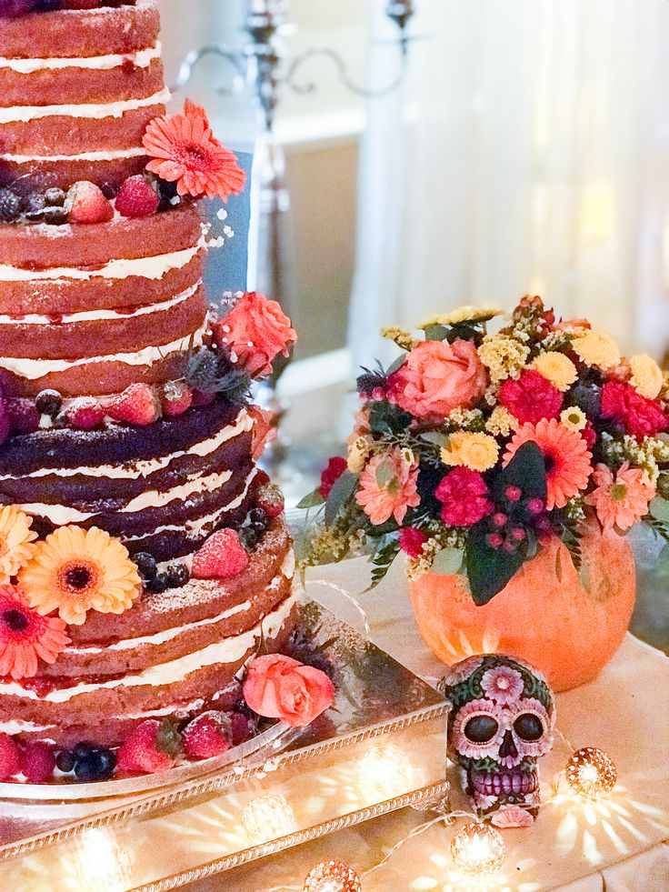 Halloween themed naked cake. Love the flowers in the pumpkin!