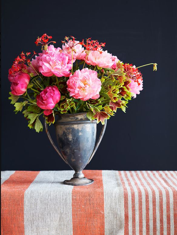 Vintage vase, peonies, stripe table cloth; this is perfection!