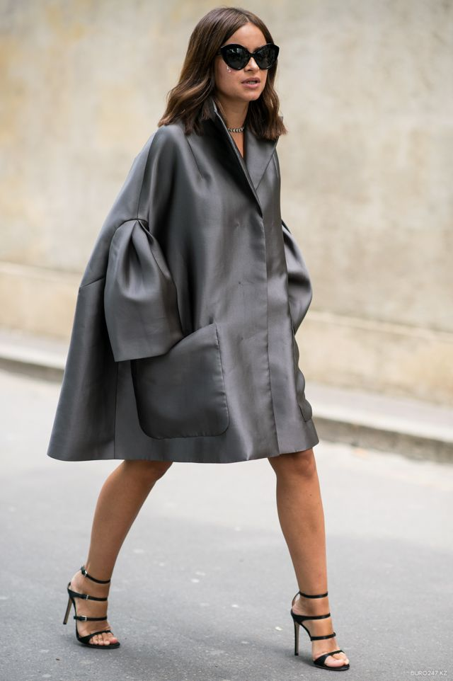 cape.coat + strappy sandals! love the mix between feminine & masculine