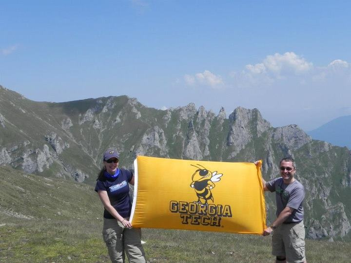 Annie Antón and Raúl Pino hiking #Romania's Transylvanian Alps (with www.trekkingforkids.org) this summer representing our alma mater, Georgia Tech! #GT