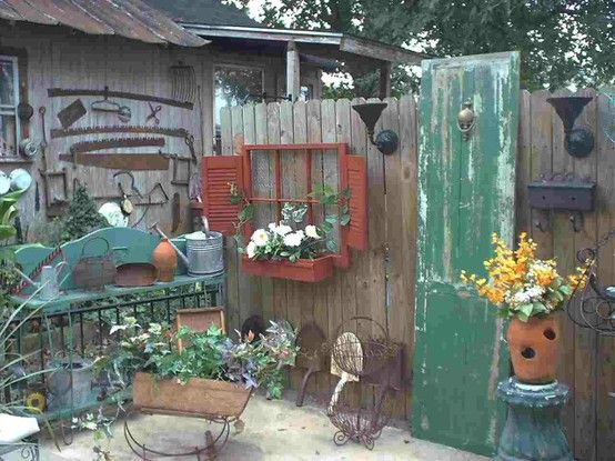 I especially like the red window/shutters/flower box.....  Garden Junk Room