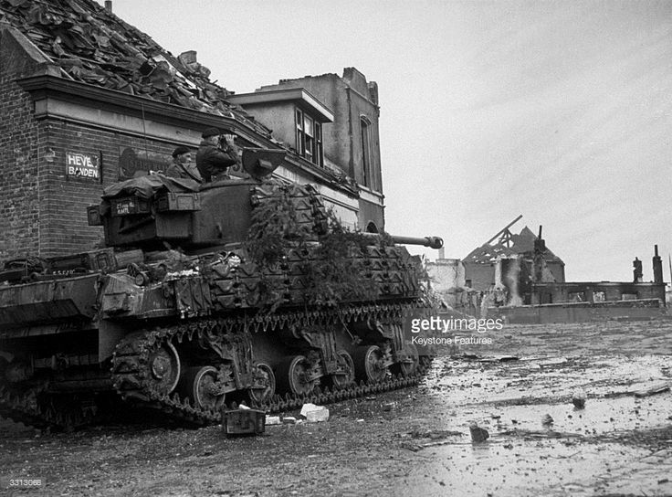 Polish armour using Sherman Firefly VC in the devastated town of Moerdijk on the Lower Rhine, during their advance through Holland.