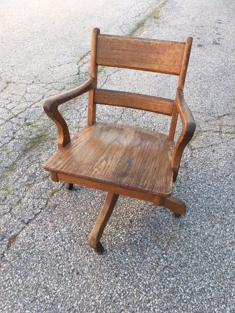 Vintage office furniture available to rent through Bygone Theatre. Vintage 1940s oak office chair with wheels.