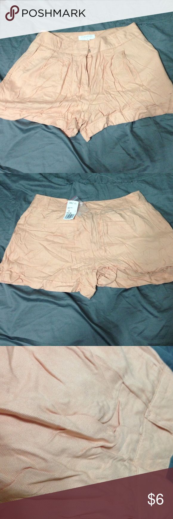Peach shorts forever 21 Great condition. I don't have an iron so they're wrinkly right now but they're brand new! Forever 21 Shorts