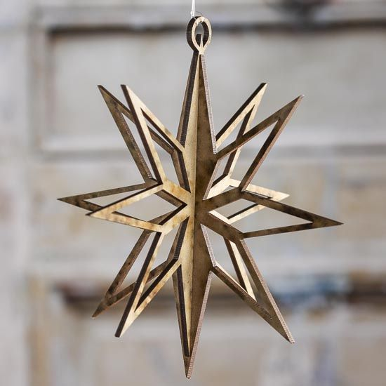 """dimensional wooden star ornament is made of composite wood and is laser cut for precise symmetrical design, crisp burned edges and added depth 6"""" high by 6"""" wide"""