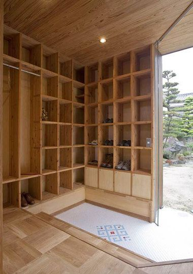 beautiful entryway in Japanese house of shelves