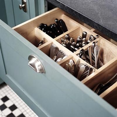 A kitchen storage idea we're bookmarking for future remodels: a deep drawer dedicated to vertical flatware storage, with side slots for larger serving utensils.